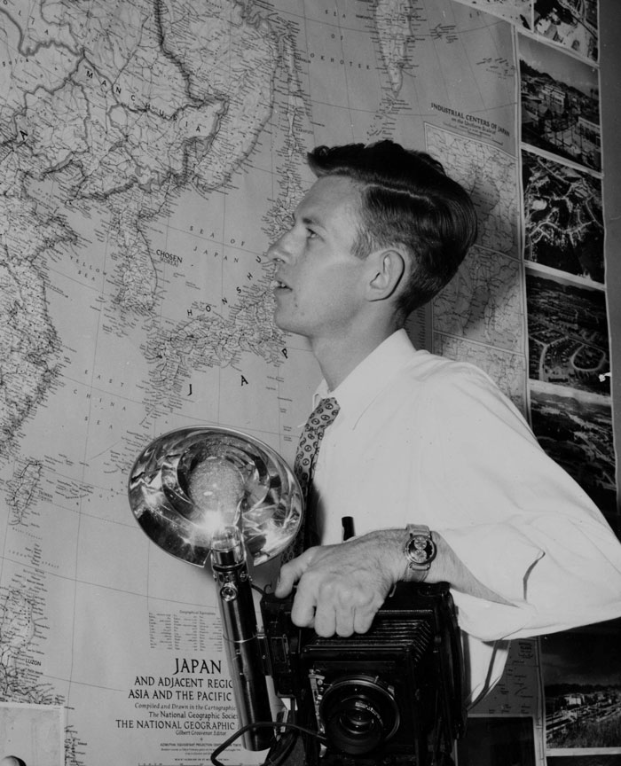 Young Ed Westcott Looking at Map