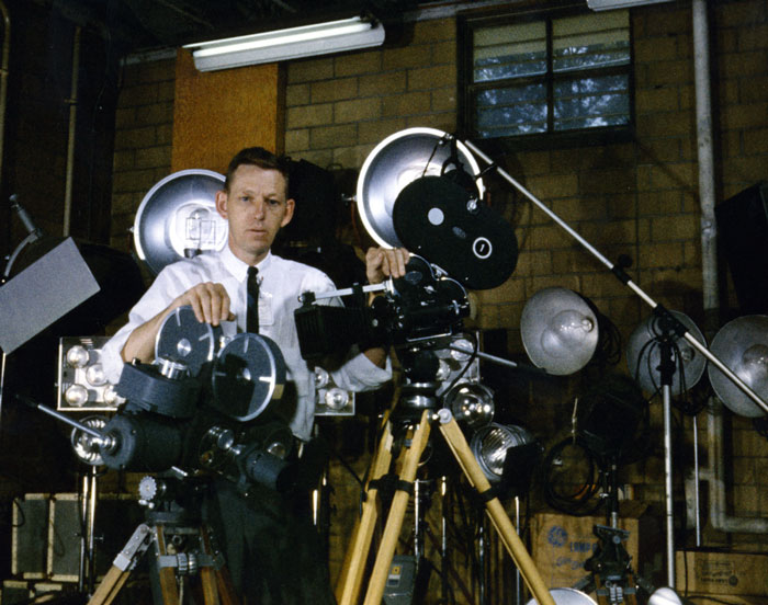 Ed Westcott Showing Camera Equipment