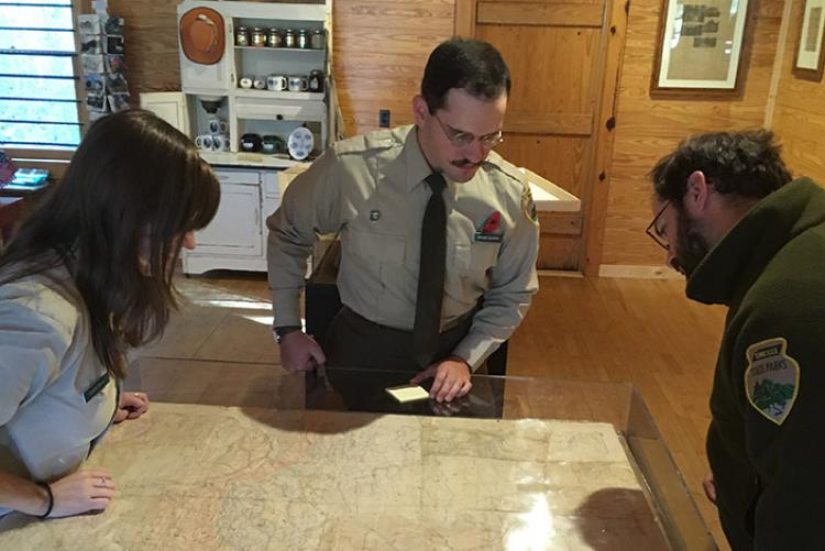 People observe a forest map used by Alvin C. York on display at Sgt. Alvin C. York State Park in Pall Mall