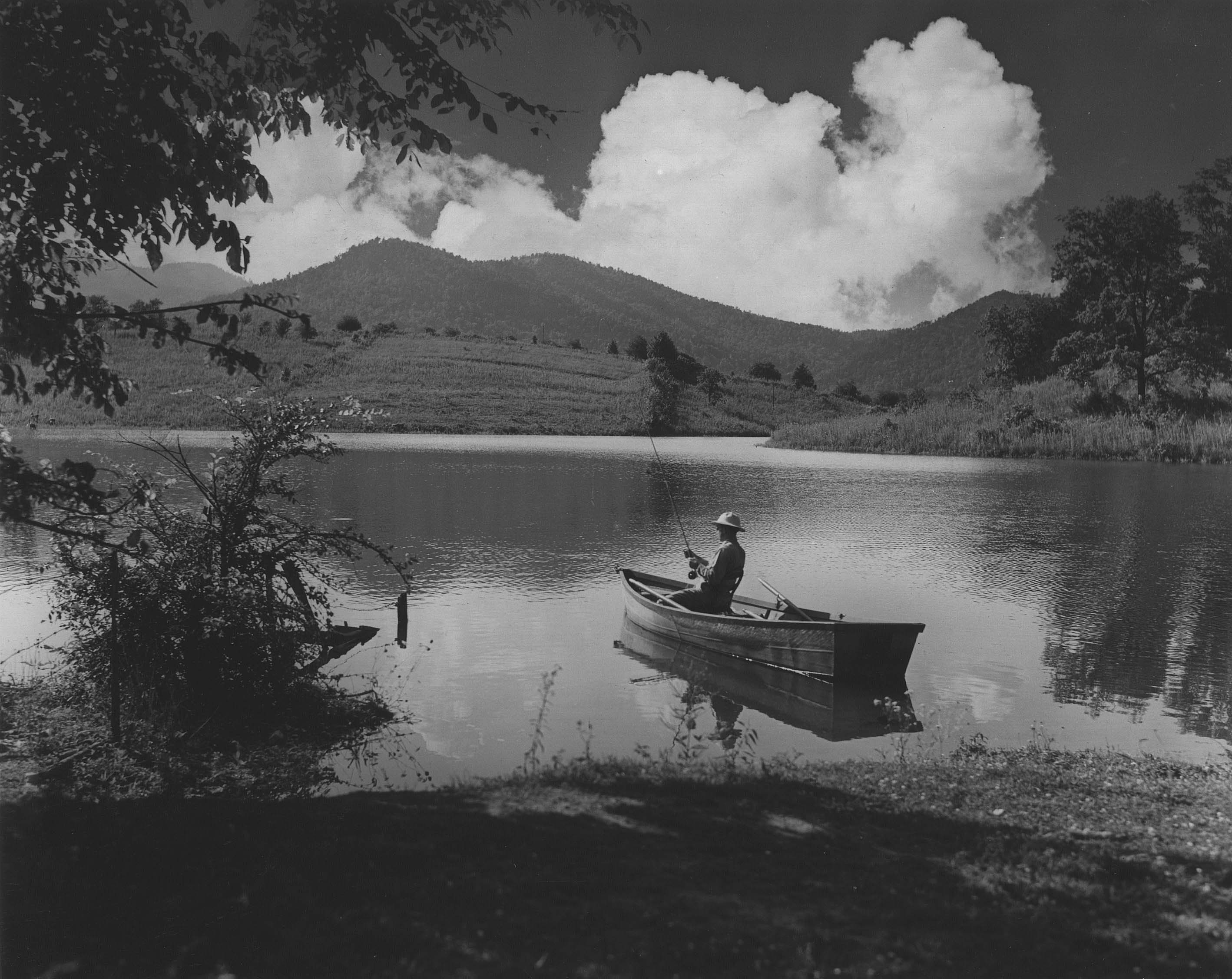 A man fishing from his boat at Cove Lake State Park near Caryville. (1938)