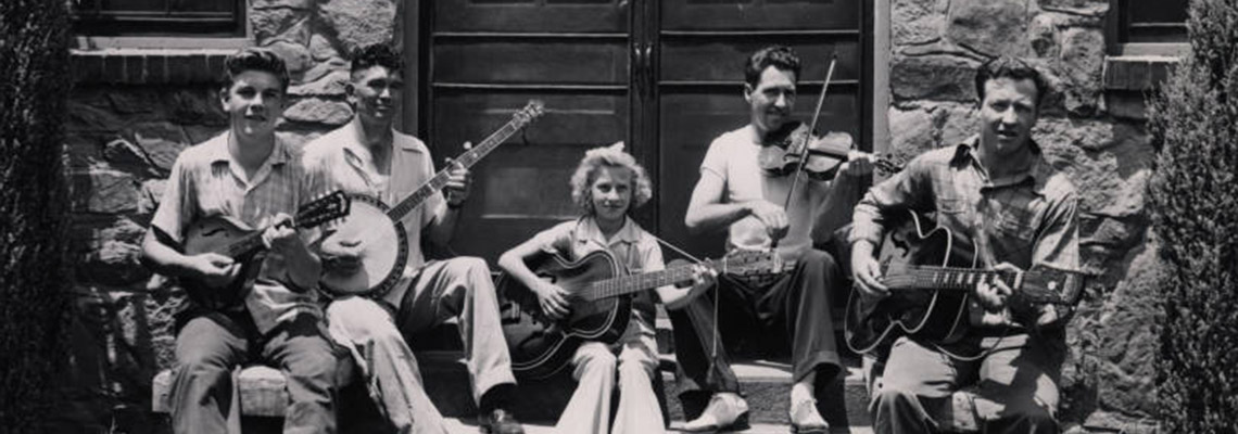 A five-member mountain band playing guitars, banjo, violin and mandolin taken in July 1945 in Sevier County.