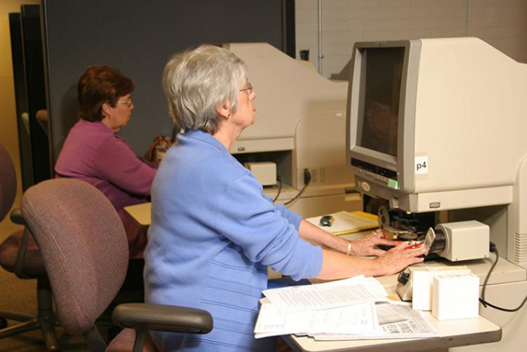 Library and Archives patrons using microfilm machines