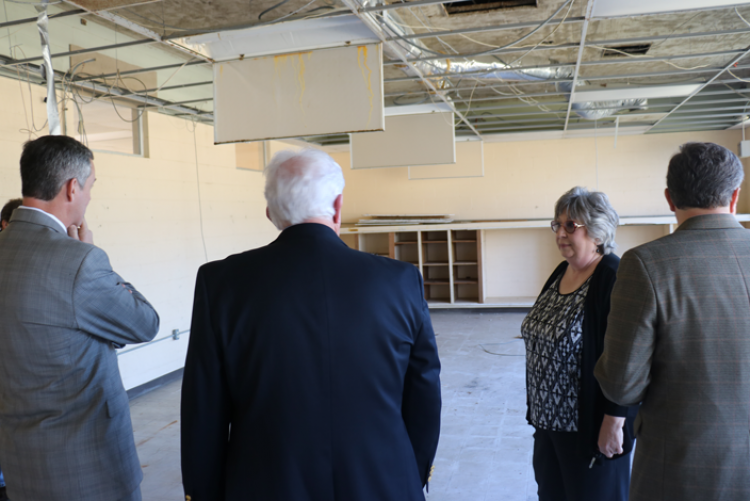 Librarian Wanza Taylor explains how the future home of the Bobby Martindale Memorial Library will be laid out.
