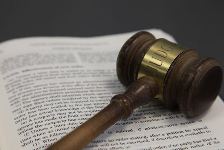 stock image of a gavel laying on top of a legal book